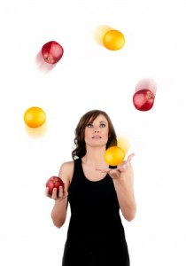 beautiful-woman-juggling-apples-and-oranges-on-a-white-backgroun
